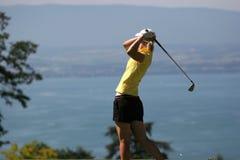 Lady golf swing at Leman lake. Lady golf swing on Leman lake Royalty Free Stock Image