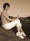 Lady Golfer. Playing golf just before sunset Royalty Free Stock Photo