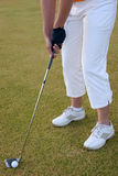 Lady Golfer. Playing golf, showing golf grip Royalty Free Stock Images