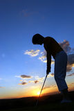Lady Golfer. Playing golf just before sunset Stock Photography