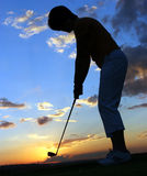 Lady Golfer. Sillhoutte of Lady golfer playing golf just before sunset Stock Image