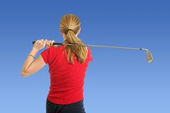 Lady Golfer. Lady hitting a drive on the driving range Stock Photo