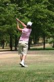 Lady golfer. On follow throufg Royalty Free Stock Photo