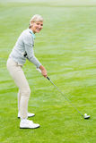 Lady golfer on the putting green Stock Image