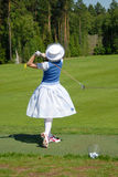 Lady golfer swing Stock Photo