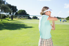 Lady golfer teeing off for the day Royalty Free Stock Images