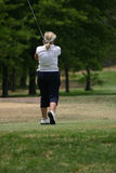 Lady golfer in white. Lady golfer after tee shot Royalty Free Stock Image