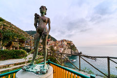 The Lady of the Grapes statue in Manarola Stock Photography