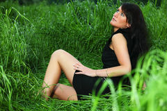 Lady in Grass Stock Image