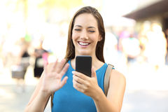 Lady greeting during a video call Stock Photos