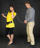 Lady guide shackled young man Stock Photo