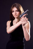 Lady and gun Stock Photography