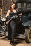 Lady with Gun Looking Away Royalty Free Stock Photos