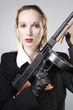 Lady with gun in studio portrait Stock Photography