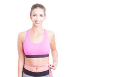Lady at gym holding tape line around waist Stock Images