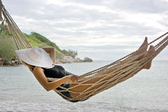 Lady in hammock Stock Images