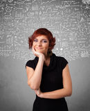 Lady with hand drawn white calculations and icons Royalty Free Stock Photos