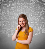 lady with hand drawn white calculations and icons Royalty Free Stock Images
