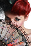 Lady with hand fan Stock Image
