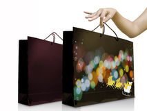 Lady hand pick up shopping bag Royalty Free Stock Photo