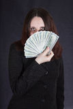 Lady handing money Royalty Free Stock Photography
