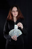 Lady handing money Royalty Free Stock Images
