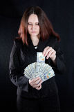 Lady handing money Stock Image