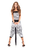 Lady in harem pants posing with black umbrella Stock Photography