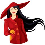 Lady in a hat. Lady in burgundy coat and wide-brimmed hat Stock Photo