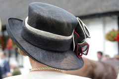 Lady with hat. Lady in a black straw hat from behind at the horse races Royalty Free Stock Image
