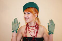The lady in a hat. The lady in a green hat and gloves stock images
