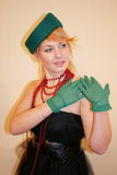 The lady in a hat. The lady in a green hat and gloves Royalty Free Stock Images