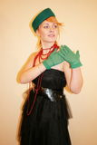 The lady in a hat. The lady in a green hat and gloves stock photo