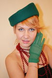 The lady in a hat. The lady in a green hat and gloves Royalty Free Stock Photos