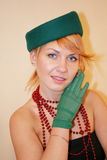 The lady in a hat. The lady in a green hat and gloves Royalty Free Stock Image