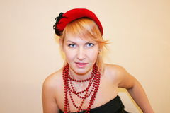 The lady in a hat. The lady in a red hat and gloves royalty free stock photos
