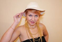 The lady in a hat. The lady in a white hat and gloves royalty free stock image