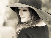 Lady in hat. Portrait of a young beautiful lady in black hat Royalty Free Stock Image