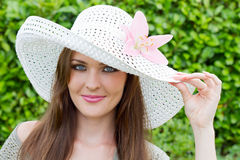 A lady with a hat Stock Image
