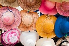 Lady hats at Otavalo market royalty free stock photography