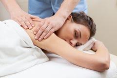 Lady having back massage Royalty Free Stock Photos