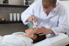 Lady having cavitation peeling in spa Stock Photography