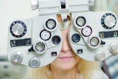 Lady having eye examination. Astigmatism stock image