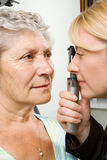 Lady having eye test examination Royalty Free Stock Image