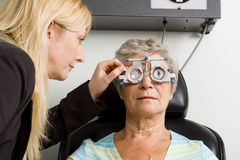 Lady having eye test examination Stock Photos