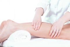 Lady having leg massage Royalty Free Stock Images