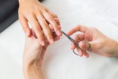 Lady having a manicure on her fingernails Stock Photos