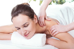 Lady having neck massage Stock Image
