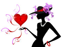Lady with heart. Pretty lady wearing hat with flowers and holding mans heart Stock Photography