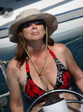 Lady at the helm royalty free stock images